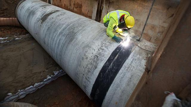 A worker working on water pipes and mains. PHOTO: LEY CHOON