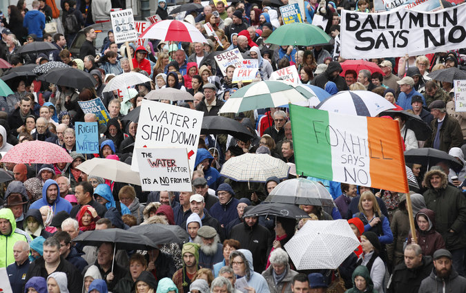 A protest in Dublin earlier this month against Ireland's plan to start charging fees for water service, which is now provided for free. Credit Peter Morrison/Associated Press