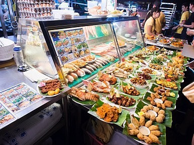 Image Credit: Singapore food stall via  T.Dallas/Shutterstock.com