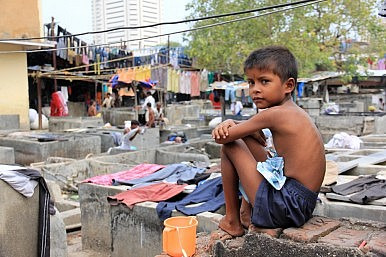 Image Credit: India slum via Narit Jindajamorn / Shutterstock.com