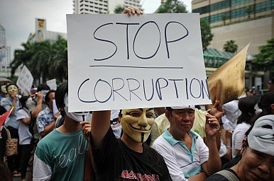 Image Credit: Corruption protest via 1000 Words / Shutterstock.com
