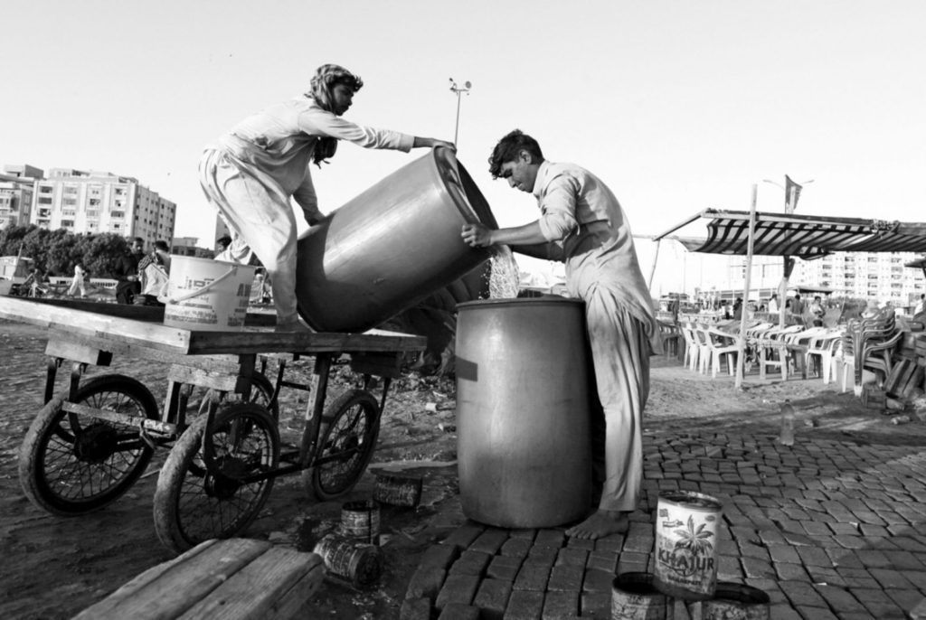 Men pouring water brought by cart into a container in Karachi, Pakistan. Some 3.5 billion people in the world do not have access to water that is safe to drink, and in South Asia — with a population of nearly 1.7 billion people — not a single city, town or village can claim that its population has access to safe drinking water. Photo: Reuters