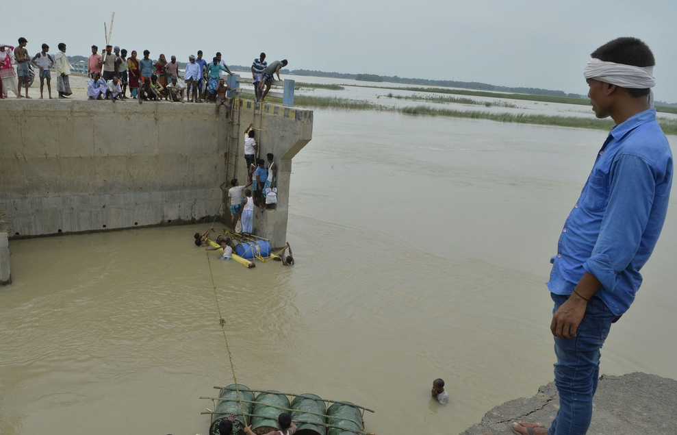 A washed away section of a bridge at Palsa village in Bihar State. Credit Diptendu Dutta/Agence France-Presse — Getty Images