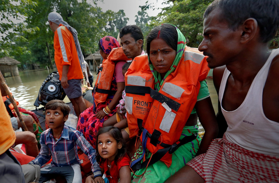 Families rescued from flooded homes in Bihar last month. Credit Cathal Mcnaughton/Reuters